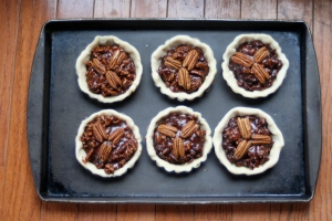 Chocolate_Pecan_Tarts_on_a_baking_sheet